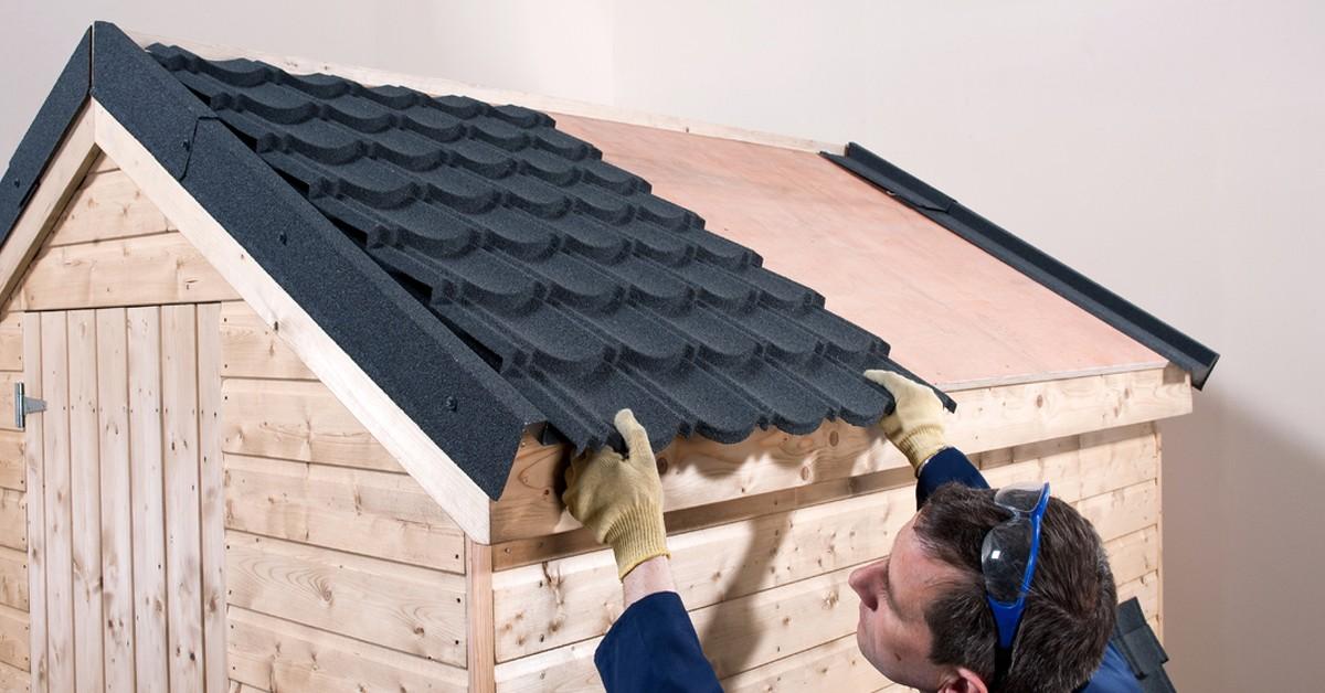 Man installing tile effect roof sheet.